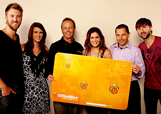 Celebrating their efforts backstage during the Music City flood relief concert were (left to right) Lady Antebellum's Charles Kelley; OfficeMax's Julie Carlson, external relations associate, and Mark Thienes, senior VP-retail stores, central territory; Lady Antebellum's Hillary Scott; OfficeMax's Paul Hertz, exec VP-retail stores; and the group's Dave Haywood.