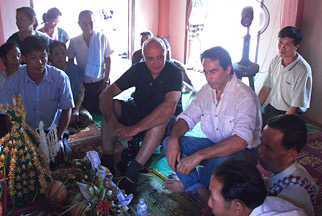 Daniel Morel, chairman-CEO of Wunderman, meets with a group of villagers from Ban Lad Hane.