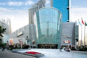 New luxury: Plaza 66, top, boasts the highest concentration of luxury brands of any mall in China. Songdo golf course and complex.