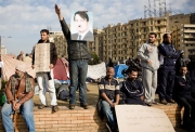 THE POSTER: Ali Ali took an old photograph of President Hosni Mubarak, added a Hitler-esque toothbrush moustache and floppy hair, and handed out copies to protesters. His Mubarak image shot around the world in news photos and blogs.