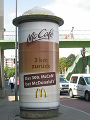 Thirsty? Giant lattes topped with frothy foam promote the 300th McCafe in Germany.