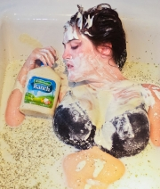 Nancy Upton poses in a tub of ranch dressing (which was actually whole milk and ranch dressing seasoning) as part of American Apparel's 'The Next Big Thing' contest.