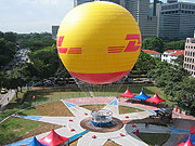 At DHL's tourist site in Singapore, visitors can take a ride in a tethered gas ballon 100 meters above the earth.