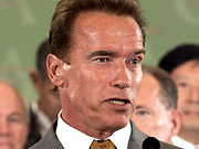 Governor Arnold Schwarzenegger ads show his opponent Phil Angelides walking backwards.