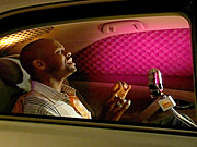 A contestant sings in the back of a Camry during one of the automaker's 'Moving Forward' intersitials.
