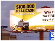 A Sportsbook.com billboard flaunted $100,000 cash to advertise contests on the company's website.