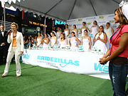 WE General Manager Kim Martin (left) counts down while Andrea De Soto (right), the Bridezilla featured in the first episode of season four, stands by.
