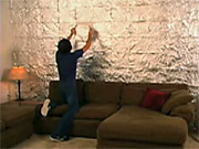 'The Wall' features two star-crossed college lovers in apartments opposite from each other polishing off their latest burritos and burrito bowls and adding the containers and wrappers to their respective walls.