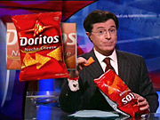 Stephen Colbert, shown with his presidential campaign sponsor, Doritos, may discover the FEC doesn't have a strong sense of humor, says one Washington insider.