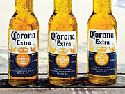 Corona Extra sales halfway through the summer selling season are basically flat due, in part, to new domestic competitors such as Bud Light Lime and Miller Chill.