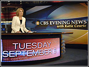 Katie Couric behind her new anchor's desk.