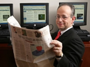 Dow Jones Exec VP L. Gordon Crovitz says readers do not view the 'Weekend Edition' 'as work; they view it as a great read.'