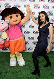 Salma Hayek, the bilingual spokesperson for the National Parents and Teachers Association and the Children's Defense Fund upcoming 'Beyond the Backpack' initiative, gives Dora a high-five in celebration of the Nickelodeon heroine's tenth anniversary.