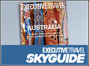 The company will begin early next month with a site for Executive Travel SkyGuide using a platform developed by Seattle's Wetpaint that will allow visitors to post reviews and articles alongside staff writers' content.