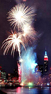 Fireworks bursting over Manhattan during Macy's famed July 4th show.