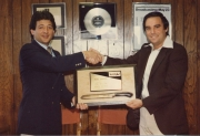 Barry Becher (right) receives award for selling 1 million knives