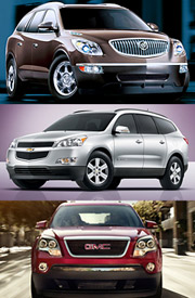 Several models under each of GM's brands are butting heads with similar models at sibling brands, including Chevy's new Traverse crossover SUV (middle).