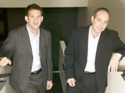 The suit names Spot Runner chairman-CEO Nick Grouf (left), and co-founder and chief technology officer David Waxman (right).