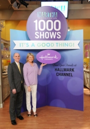 Bill Abbott, President and CEO of Crown Media Networks, presents a jumbo Hallmark card to Martha Stewart in celebration her 1,000th episode of 'The Martha Stewart Show' on Hallmark Channel