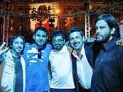 Bathed in blue light at the Cannes closing gala at the Carlton Hotel, Grupo Gallegos executives celebrate a Bronze Film Lion win: (l to r) Juan Oubina, Curro Chozas, Saul Escobar, John Gallegos and Favio Ucedo.