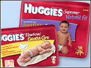 Kimberly-Clark has improved its superpremium Huggies line and is rolling out a new ad campaign to help maintain its sales edge against rival Procter and Gamble.