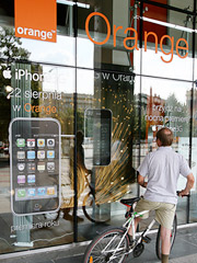 Orange is saying rumors that the company has hired people to stand outside stores in Poland and create phony lines is untrue.