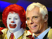 McDonald's president-COO Mike Roberts, who is leaving the restaurant chain, is shown here with Ronald McDonald at a recent company event. Mr. Roberts joined McDonald's in 1977 as a regional purchasing manager and rose through the ranks.