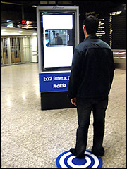 Swivel, point, shoot, click: A piece of street furniture gets interactive in a Lisbon airport.