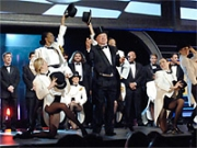 William Shatner, backed up by the male stars of ABC shows, onstage at the network's presentation.