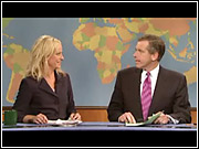 Amy Poehler and Brian Williams during 'Weekend Update' on 'SNL.'