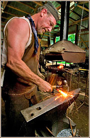 Michael Stelzer, president of the Marlin Co. ad agency in Springfield, Mo., spends his spare time in his blacksmithing barn.