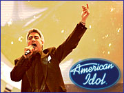 Taylor Hicks in his triumphant performance as this year's 'American Idol.' The Fox TV show has mushroomed into a media phenomenon that now feeds a sprawling $2.5 billion economy.