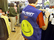 Wal-Mart's logo, which doesn't appear in new ads, will still be featured in other ways by the retailer.