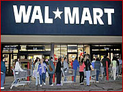 Fifteen minutes after Friday's 5 a.m. opening, shoppers at this Williston, Vt., Wal-Mart still waited in line to enter the store. Many arrived to take up their place in line shortly after midnight.