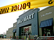 Police tape blocks access at the Wal-Mart in Valley Stream, N.Y. A temporary worker was trampled to death there by Black Friday Christmas shoppers.