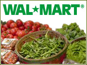 Wal-Mart is moving into the organic food field with a marketing campaign emphasizing low prices.