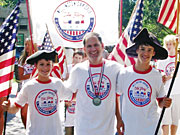 Tony Weisman, chief marketing officer of Draft, Chicago, is parade marshal of the Wellington-Oakdale Old Glory Marching Society.