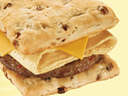 Wendy's said it would retool in-store displays and marketing messages to make its breakfast products, like the maple-baked 'frescuit,' stand out from those at McDonald's.