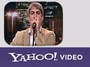 Yahoo is using its contacts in news and entertainment media to complement the site's amateur offerings, while avoiding the licensing issues that sites like YouTube have faced.