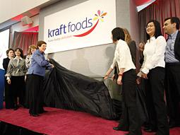Kraft Chairman-CEO Irene Rosenfeld (in blue) unveils the new logo internally at the company's Northfield, Ill., headquarters last week.