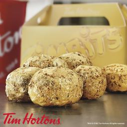 Tim Hortons is offering 24k Gold Timbits in five restaurants for National Donut Day.