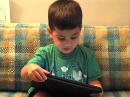 THE 'I' GENERATION: It took our 3-year-old experimenter, Everett, only a few minutes to figure out the swiping motion to move from page to page on the iPad, and before long he was launching apps and backing out of them when he got tired of them.