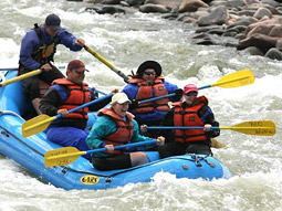 GO PLAY: A work-hard, play-hard environment at Go Daddy makes whitewater rafting trips a priority.