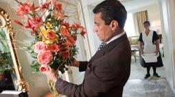 Aziz Bendriss arranges a bouquet as head housekeeper Ella looks on.