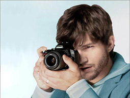 Candid camera: Kutcher's busy selling Nikons ... and himself.