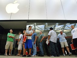 Customers in line to purchase an iPhone