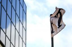A Financial Times flag flutters outside its headquarters in London.