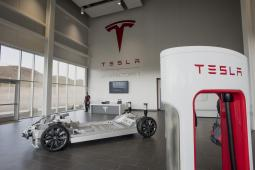 A vehicle charger, right, stands in the lobby at the Tesla Motors Gigafactory in McCarran, Nevada.