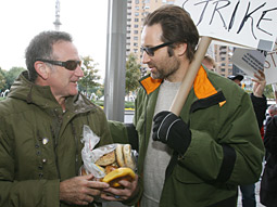 High-profile picketers: Robin Williams and David Duchovny take to the streets in New York.