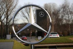 A Mercedes-Benz AG three-pointed star logo.